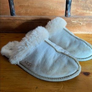 Ugg cream colored slippers.